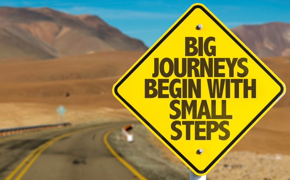 tips to build a solid content journey for your buyers main image; big journey begin with small steps written on yellow diamond street sign