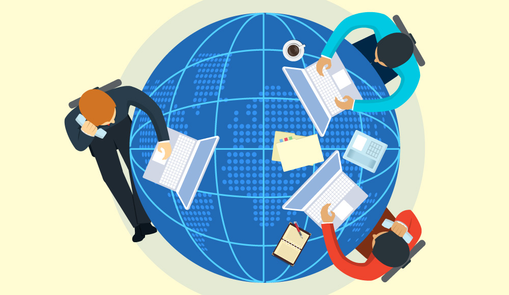 How to help a freelancer or agency help you with your blog main image; globe used as a table with 3 persons with laptops having a meeting