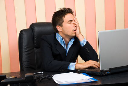 16 Ways you are killing your business main image; Stressed business man with problems on laptop holding face in his hand