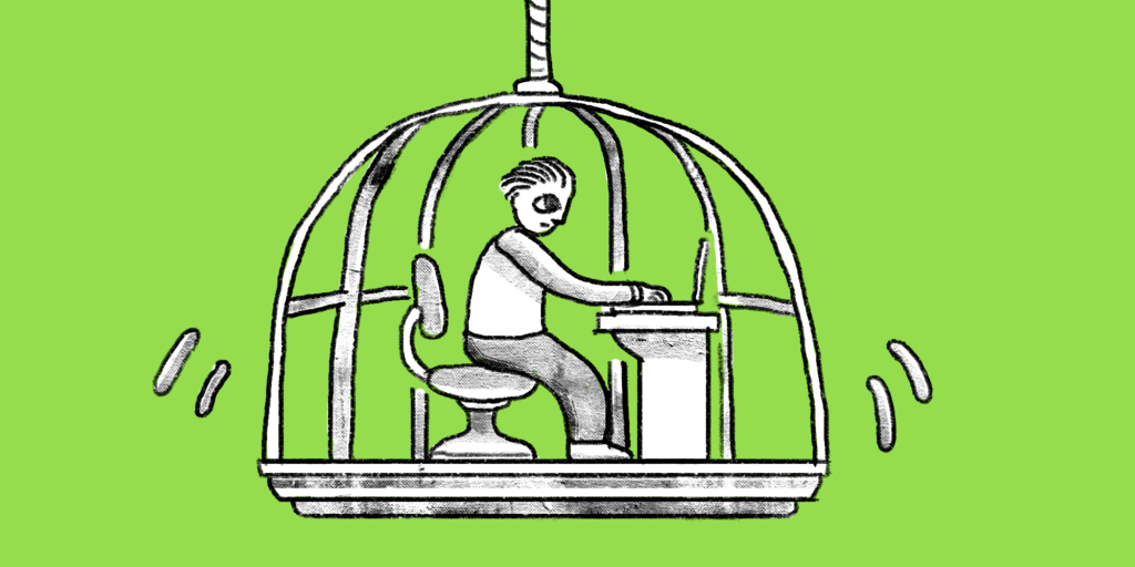 man on computer in birdcage